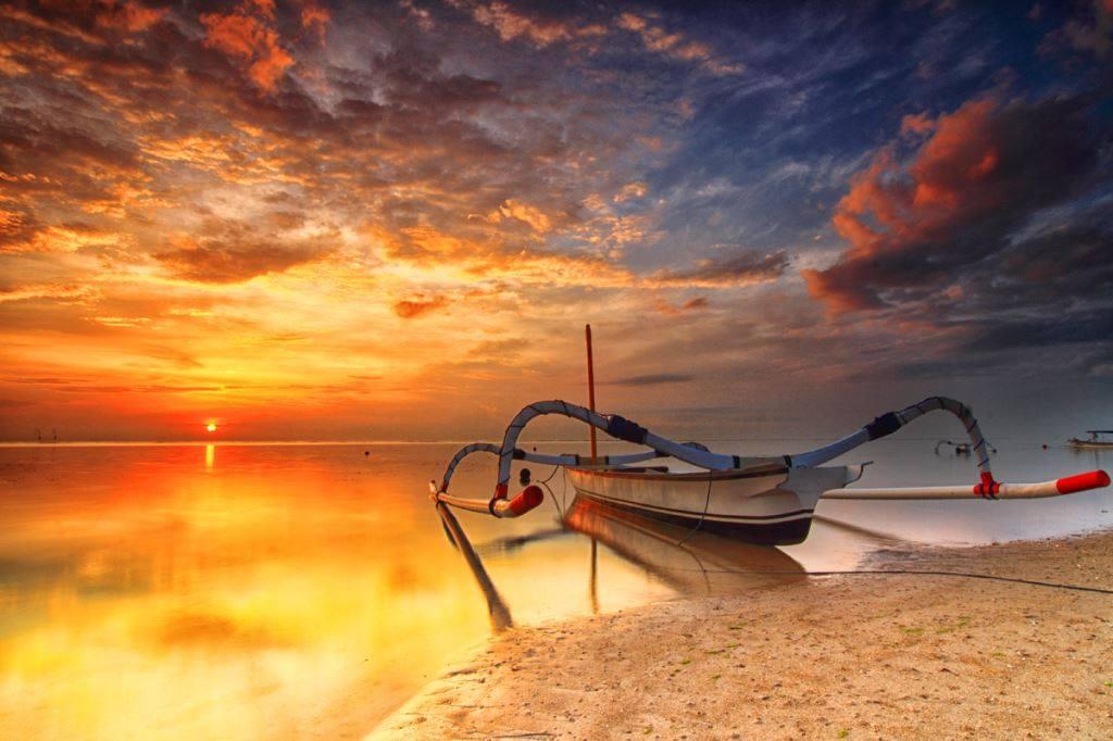 Boat near shore with sunrise